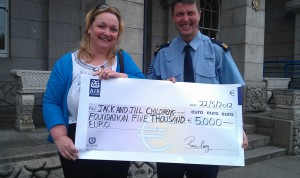 Sergeant Ronan Carey pictured with Jack and Jill Liaison Nurse, Anne Reilly