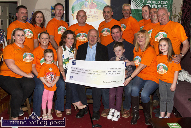Jonathan Irwin (seated centre) pictured receiving a cheque for €20,202.50 from the organisers and participants of The Longest Day Charity event. Included are, front: Norma Nolan-Moran, Eileen and Abbie Greaney, Fiona Clifford, Mr. Irwin, Ted and Conor Clifford, Georgina Fagan and Maria Greaney. Back row: Mike O'Sullivan, Maria Brosnan, Tom McCarthy, host; Denny Greaney, Gerry Fagan, Hugh O'Connor, Kevin Moran, Jerry Flynn and Jerry Courtney. ©Photograph: John Reidy