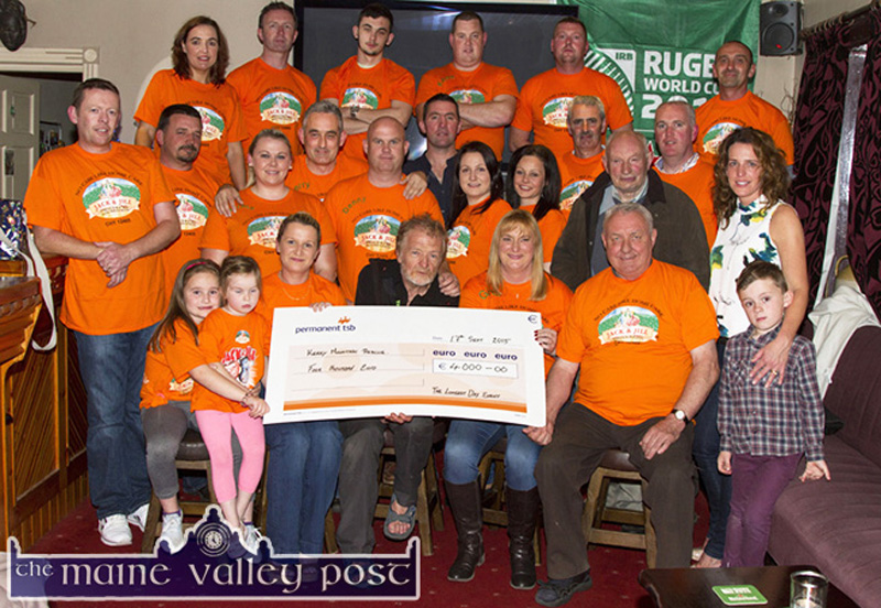 Kerry Mountain Rescue representative, Gerry Christie (seated centre) pictured receiving a cheque for €4,000 from the organisers and participants of The Longest Day Charity event. Included are, front: Maria, Abbie and Eileen Greaney, Mr. Christie, Georgina Fagan, Jerry Courtney and Conor Clifford. Second row: Tony Nolan, Mike O'Sullivan, Norma Nolan-Moran, Gerry Fagan, Denny Greaney, Ted Clifford, Noranne Scollard, Pam Carmody, Hugh O'Connor, Tim O'Sullivan, Michael O'Brien and Fiona Clifford. Back row: Maria Brosnan, Tom McCarthy, host; Cian Fagan, Kevin Moran, David Carmody and Jerry Flynn. ©Photograph: John Reidy