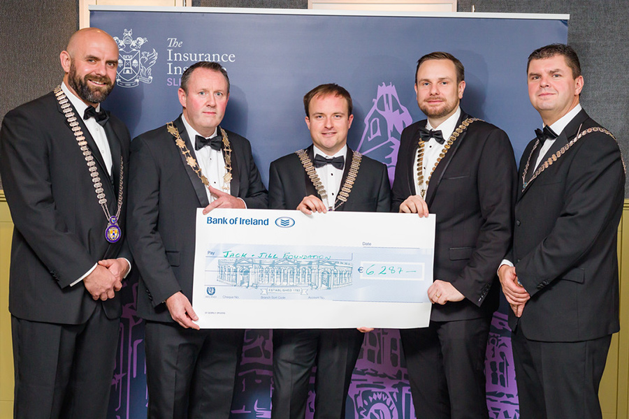 Insurance Institute Council Network Hell & Back cheque handover
