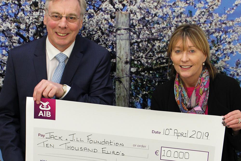 O'Briens presenting Jack &Jill a cheque