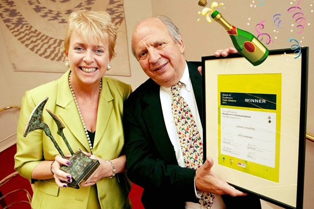 Jonathan & CEO Carmel Doyle winning the PRII Award